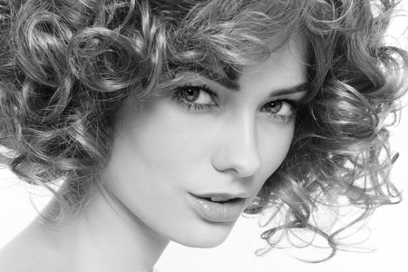 permanent wave: Black and white portrait of young beautiful woman with curly hair Stock Photo