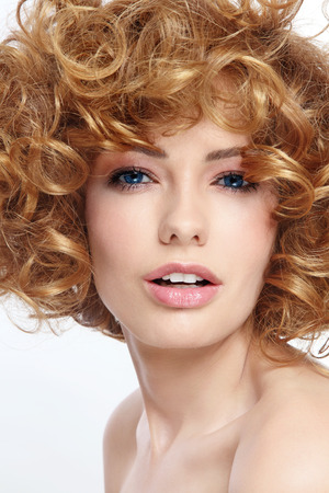 perming: Portrait of young beautiful sexy woman with curly hair