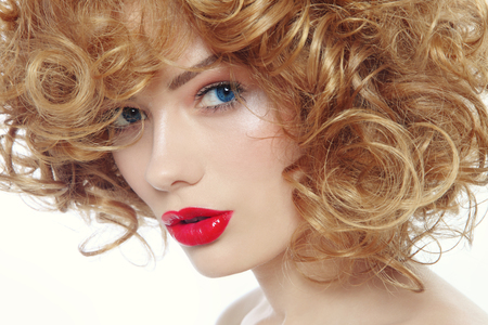 permanent wave: Close-up portrait of young beautiful woman with red lipstick Stock Photo