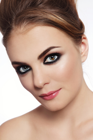 smoky eyes: Close-up portrait of young beautiful stylish woman with smoky eyes
