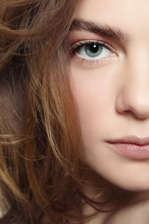 Close-up portrait of young beautiful girl with clean make-up