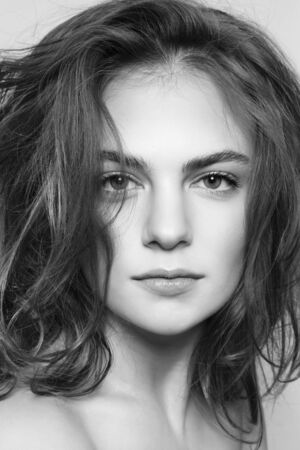 messy hairstyle: Black and white portrait of young beautiful girl with clean make-up and messy hairstyle