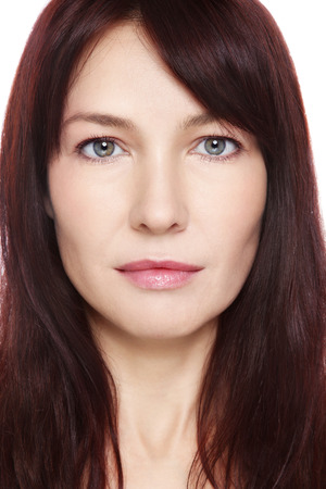 Portrait of beautiful middle-aged woman with clean make-up over white background photo
