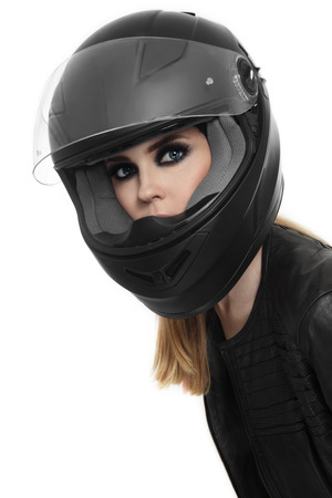 Portrait of young beautiful woman in biker helmet over white background photo