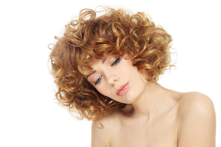 permanent wave: Young beautiful sexy woman with curly hair over white background