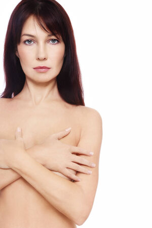 Beautiful slim mature woman over white background photo