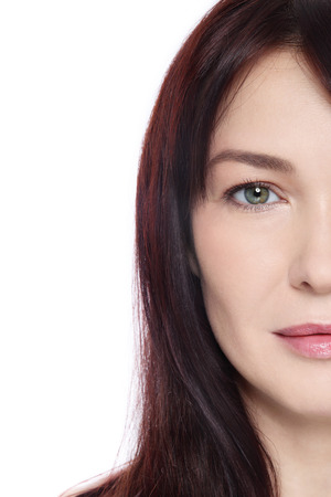 ageing: Face of beautiful middle-aged woman with clean make-up over white background