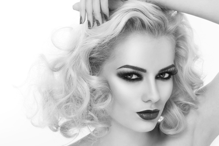 smoky eyes: Black and white close-up portrait of young beautiful woman with smoky eyes and blond curly hair