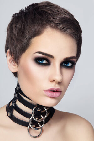slave girl: Portrait of young beautiful sexy woman in black leather collar