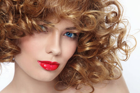 permanent wave: Close-up portrait of young beautiful woman with curly hair and red lipstick