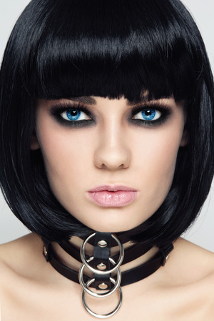 slave girl: Close-up portrait of young beautiful sexy brunette in black leather collar