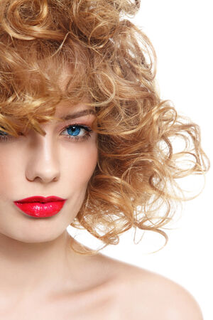 perming: Portrait of young beautiful woman with curly hair and red lipstick over white  Stock Photo
