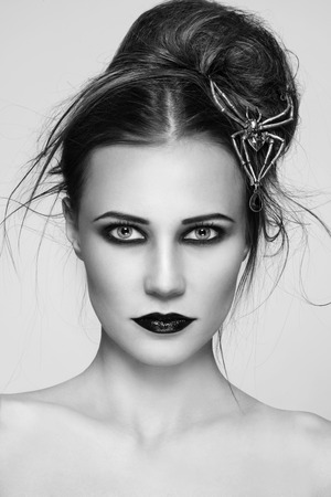 gothic girl: Black and white portrait of young beautiful woman with stylish gothic make-up and hairdo Stock Photo