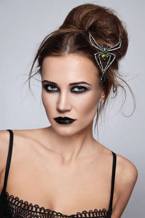 succubus: Young beautiful woman with stylish gothic make-up and hairdo