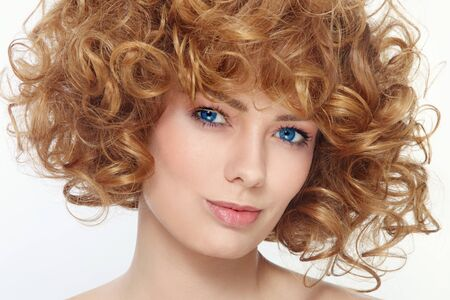 permanent wave: Close-up portrait of young beautiful healthy woman with curly hair Stock Photo