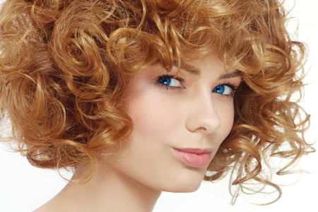perming: Close-up portrait of young beautiful healthy woman with curly hair Stock Photo
