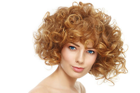 perming: Portrait of young beautiful healthy woman with stylish curly hairdo over white background Stock Photo