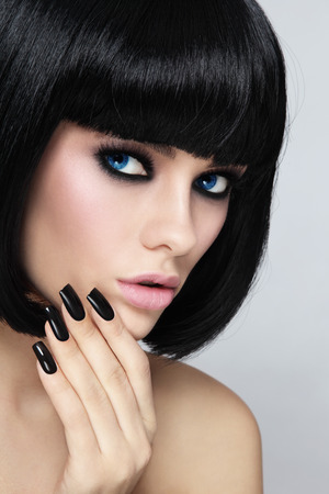 wig: Young beautiful sexy woman with stylish bob haircut and black manicure Stock Photo