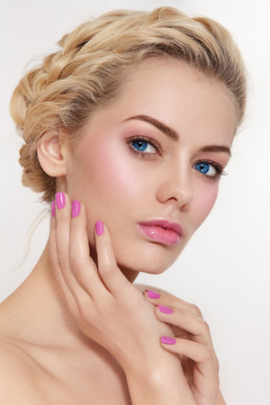 pink nail polish: Portrait of young beautiful blond girl with fresh pink make-up and manicure