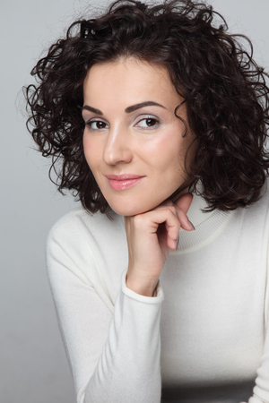 permanent wave: Young attractive woman with curly hair in casual outfit