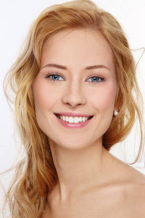 lovely women: Portrait of young beautiful happy smiling girl with curly hair and clean make-up