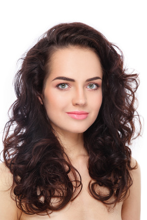 Portrait of young beautiful woman with fresh clean make-up and curly hair over white background