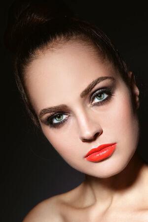 Close-up portrait of young beautiful woman with stylish make-up photo