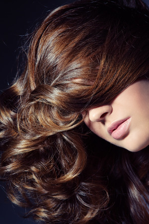 Close-up shot of woman with long curly hair photo