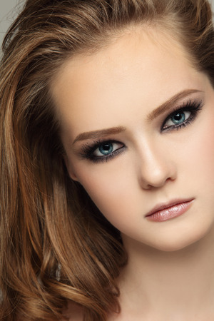 smoky eyes: Close-up portrait of young beautiful teen girl with smoky eyes make-up
