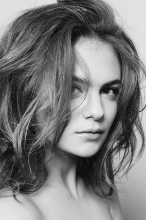 messy hairstyle: Black and white portrait of young beautiful sexy girl with clean make-up and messy hairdo