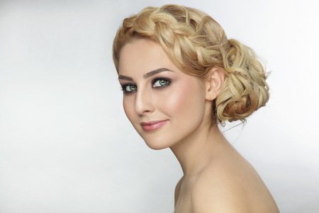 braids: Portrait of young beautiful blonde woman with stylish prom hairdo
