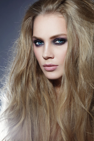 smoky eyes: Young beautiful sexy woman with long blonde hair and smoky eyes