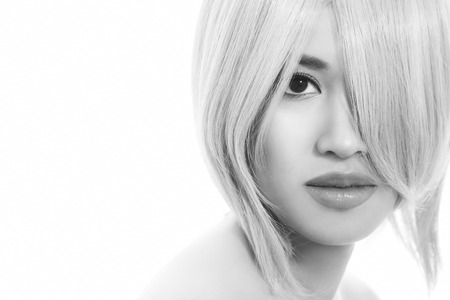 fillers: Black and white close-up portrait of young beautiful asian girl with stylish haircut over white background