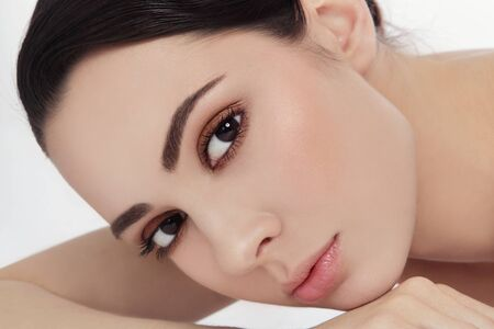 eye brow: Close-up portrait of young beautiful woman with stylish make-up