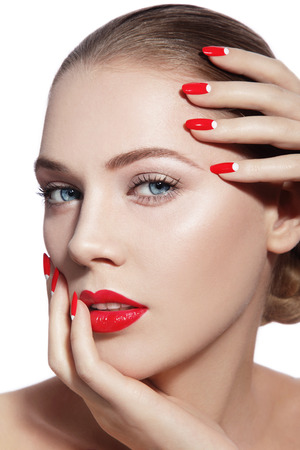 cheekbones: Close-up portrait of young beautiful woman with red lips and fancy manicure over white background