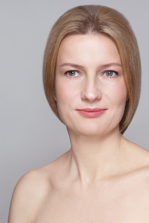 natural face: Portrait of beautiful smiling mature woman with clean make-up