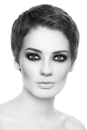 smoky black: Black and white portrait of young beautiful woman with sylish short haircut and smoky eyes over white background
