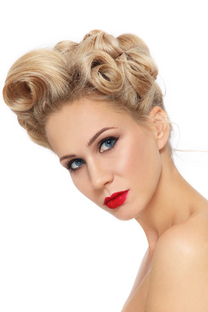 perming: Portrait of young beautiful blonde girl with stylish fancy pin-up hairdo over white background