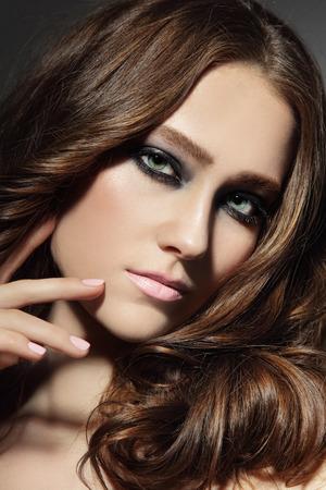 Portrait of young beautiful woman with stylish smokey eyes photo
