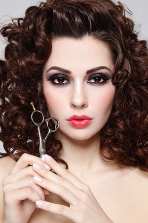 permanent wave: Portrait of young beautiful woman with long healthy curly hair