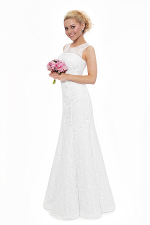 bride dress: Young slim beautiful blonde happy smiling bride in lacy dress over white background