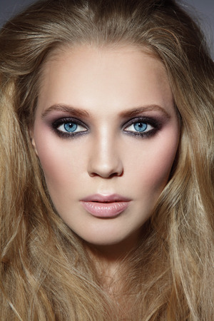 messy hair: Close-up portrait of young beautiful stylish woman with smoky eyes