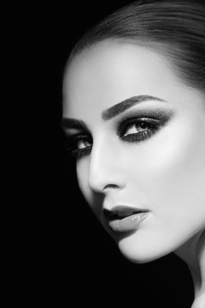 Black and white portrait of young beautiful woman with smoky eyes, copy space Stock Photo