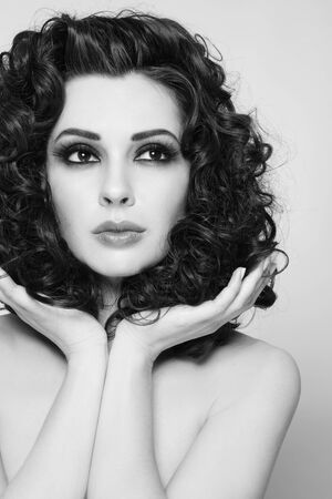 permanent wave: Black and white portrait of young beautiful woman with long healthy curly hair