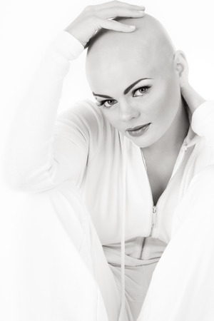 skinhead: Black and white photo of young beautifil skinhead woman