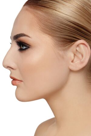 cheekbones: Profile portrait of young beautiful woman over white background
