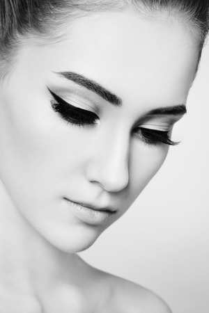 female eyes: Close-up black and white portrait of young beautiful girl with cat eye make-up Stock Photo