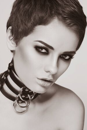beautiful bdsm: Sepia portrait of young beautiful sexy woman in black leather collar