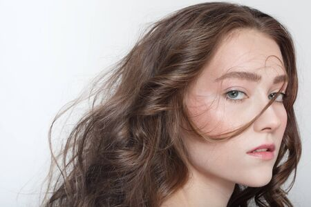 messy hair: Portrait of young beautiful girl with long healthy curly hair Stock Photo