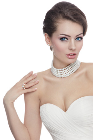 Young beautiful slim bride with stylish make-up and hairdo over white background with copy space Stock Photo